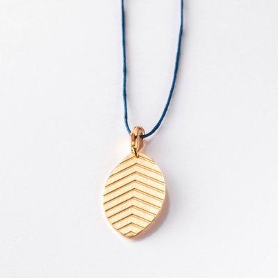 Little Leaf Tabacco Gold Pendant on Dark Blue Lace