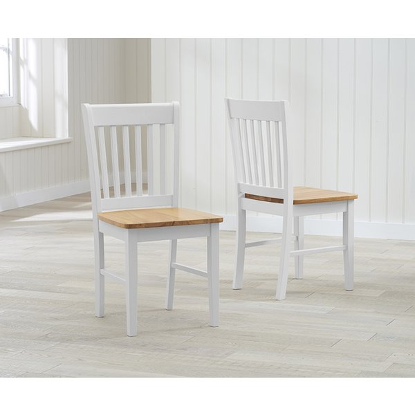 37. Amalfi Oak and White Dining Chairs (Pair): £90, Great Furniture Trading Company
