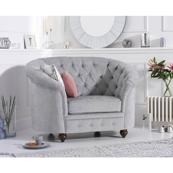 41. Cara Chesterfield Grey Plush Fabric Armchair: £339, Great Furniture Trading Company