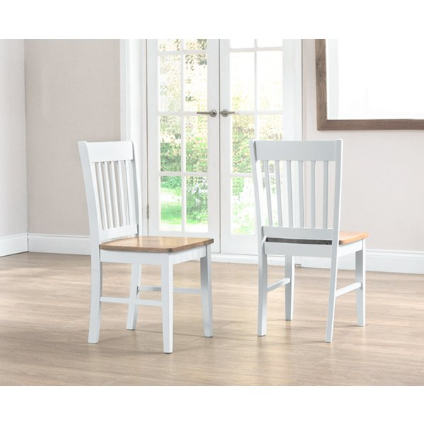 37. Genoa Oak and White Dining Chairs (Pair): £90, Great Furniture Trading Company