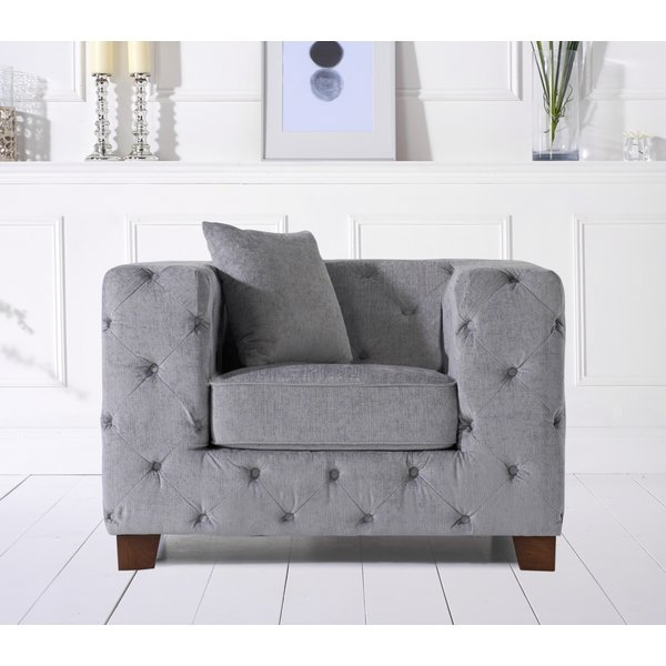 40. Harrison Chesterfield Grey Plush Armchair: £399, Great Furniture Trading Company
