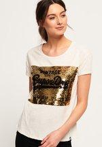 T-shirt Crema donna T-shirt boyfriend slim con paillettes Premium