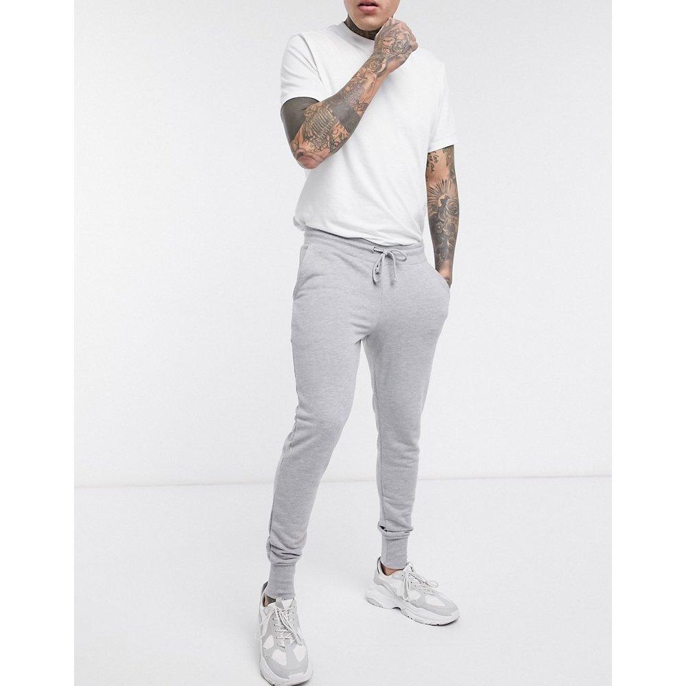 Pantalon de jogging super ajusté - chiné - ASOS DESIGN - Modalova