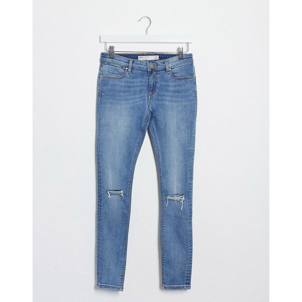 Whitby - Jean skinny taille basse à déchirures - Délavage clair - ASOS DESIGN - Modalova
