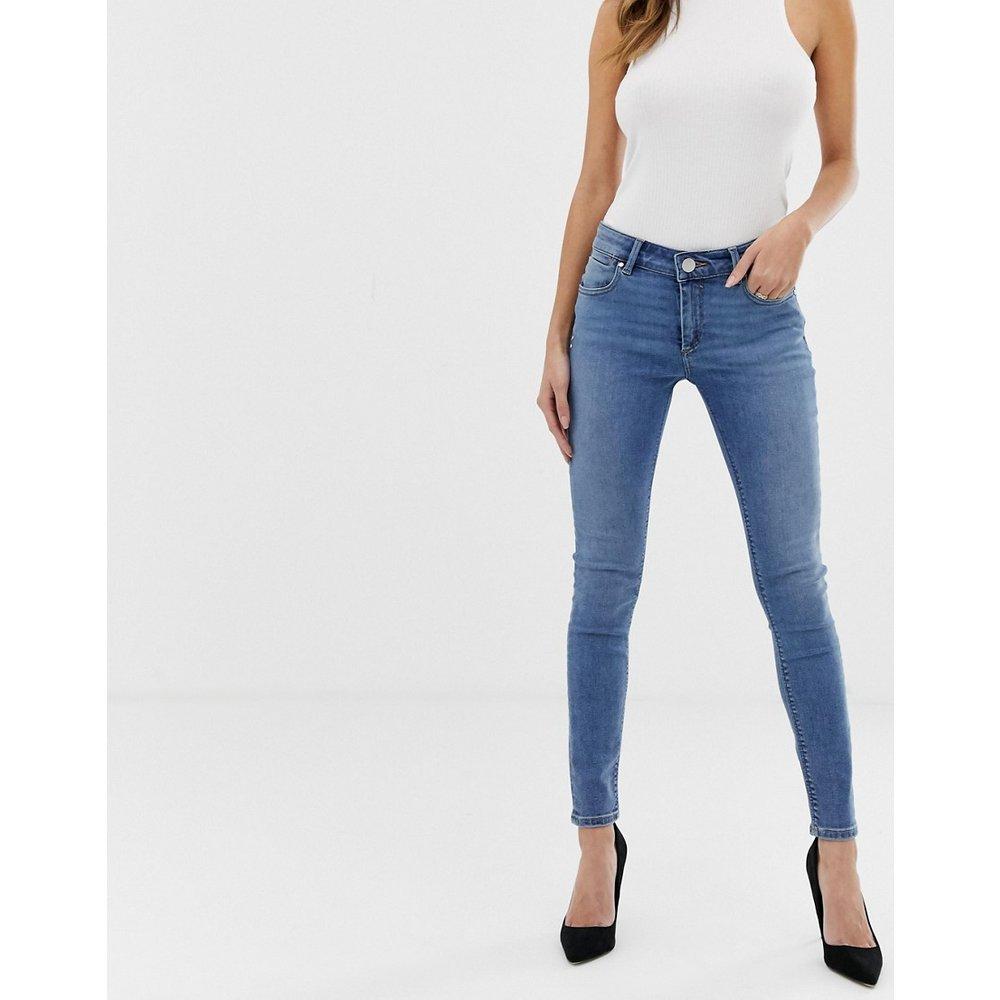 Whitby - Jean skinny taille basse - délavé moyen - ASOS DESIGN - Modalova
