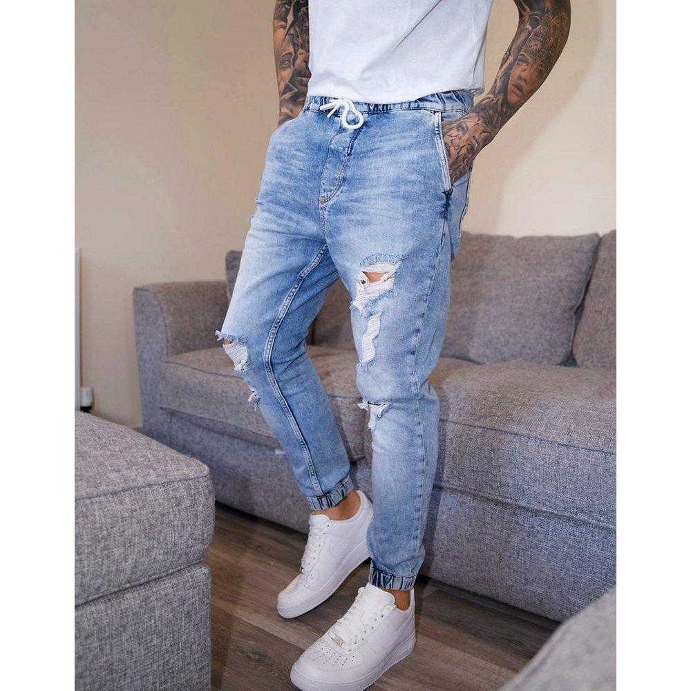 Jogger en jean avec déchirures - clair délavé - Bershka - Modalova