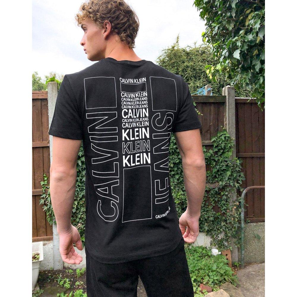T-shirt à imprimé skateur au dos - Calvin Klein Jeans - Modalova