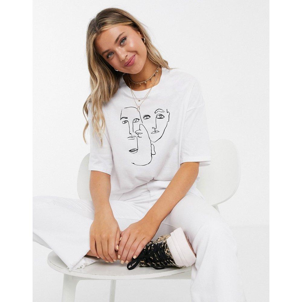 Damali - T-shirt en coton biologique à imprimé visage - Monki - Modalova