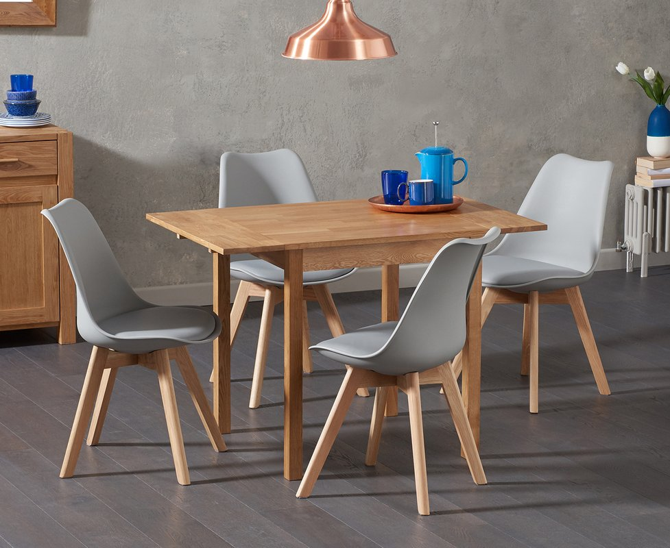 Photo of Oxford 70cm Solid Oak Extending Dining Table With Duke Faux Leather Chairs