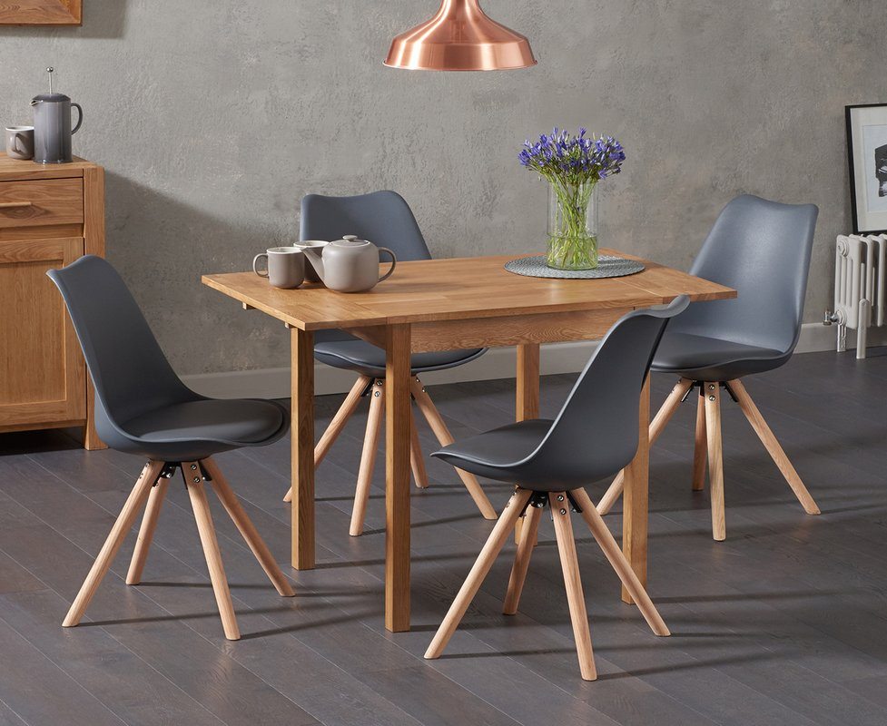 Photo of Oxford 70cm Solid Oak Extending Dining Table With Oscar Round Leg Faux Leather Chairs