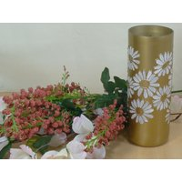 Gold coloured vase decorated with white daisies.  Made from a wine bottle and hand painted.  Ideal gift.