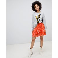Soaked In Luxury Printed Wrap Skirt With Ruffle - Pumpkin
