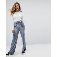 Pantalones de pernera ancha en terciopelo de Missguided