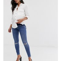 ASOS DESIGN Maternity lisbon mid rise skinny jeans in mid wash blue with frayed knee rips and under