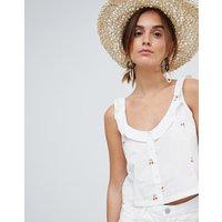 Camiseta corta de tirantes con estampado de cerezas y botones en blanco de Mango