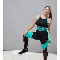Leggings con paneles en negro y verde exclusivos en ASOS de Puma Plus