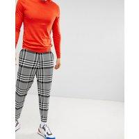 Pantalones de vestir tapered con diseño de cuadros extragrandes de ASOS DESIGN