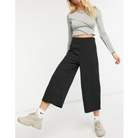 Pantalones de pernera ancha capri en negro con diseño de crepé de punto de ASOS DESIGN