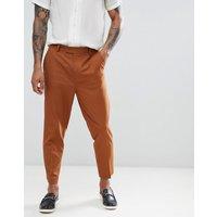 Pantalones de vestir tapered en color tostado de ASOS DESIGN