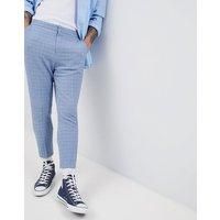 Pantalones de vestir tapered en azul con textura y espalda elástica de ASOS DESIGN