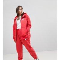 90f64ce6c4925d Asos. Nike Plus - Rally - Pantaloni della tuta con fondo aderente rossi -  Rosso