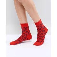 Calcetines de leopardo en rojos de ASOS DESIGN