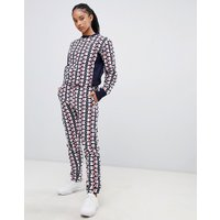 Champion tracksuit bottoms in all over print reverse weave co-ord - Navy multi