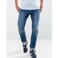 LDN DNM Skinny Jeans in Indigo with Ripped Knees - Blue