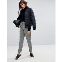 Pantalones tobilleros a cuadros de Vero Moda