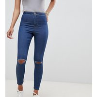 ASOS DESIGN Rivington high waisted jeggings with frayed knee rip detail in mid stone blue wash - Mid