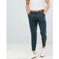 Pantalones de vestir ajustados en verde bosque de ASOS DESIGN