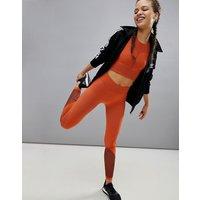 Leggings de punto cruzado en naranja de adidas Training
