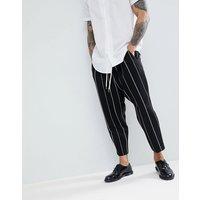 Pantalones de vestir tapered de tiro caído de tela de nido de abeja en negro con rayas blancas de ASOS DESIGN