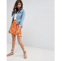 ASOSASOS Wrap Mini Skirt with Tie Waist in Ditsy Print - Orange print