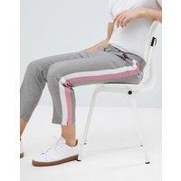 Pantalones de vestir tapered texturizados en gris con raya lateral pastel de ASOS