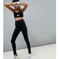 Leggings deportivos de talle alto con elastano en negro de ASOS 4505 Tall