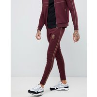 Gym King skinny joggers in burgundy with gold side stripes - Red
