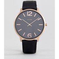 Reloj con chapado en dorado rosa y correa negra de Pilgrim