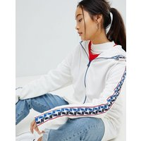 Chaqueta de chándal en blanco con media cremallera y cinta con rayas en el lateral de Nike