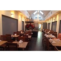 Three Course Italian Meal with a Glass of Wine for Two at La Cucina