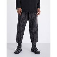 Camo-print wool trousers