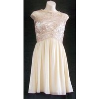 Image of BNWT Little Mistress Size: 6 short beige sleeveless dress with sweetheart neckline and lace over bodice.