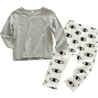 2-piece Solid Long Sleeves Top and Eyes Pattern Pants for Baby Girl