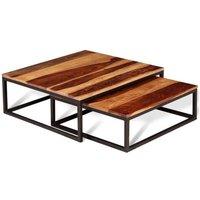 Vidaxl ensemble de table basse gigogne 2 pcs bois massif de sesham 243961. Cet ensemble de 2 tables basses gigognes au style rétro sera un ajout intemporel à votre salon, chambre à coucher ou chambre d'amis. Les dessus de table sont faits de bois massif de Sesham avec une finition mate et apporteront une touche de charme rustique à votre maison. Les beaux grains de bois rendent chacune de nos tables unique et légèrement différente l'une de l'autre. Le Sesham est un bois dur tropical qui est bien connu pour ses grains riches et aussi connu sous le nom de palissandre ou de bois de rose. Les cadres en métal hautement durables ajouteront une touche industrielle à votre intérieur. Les dessus robustes de table sont idéaux pour placer une lampe, de la nourriture et des boissons, ou des articles décoratifs comme des cadres de photo, des paniers de fruits ou des vases. Grâce à la conception d'emboîtement, ces tables vous font gagner de l'espace lorsqu'elles ne sont pas utilisées. Remarque importante : les couleurs varient d'une pièce à l'autre, rendant chacune de nos tables unique ; la livraison est aléatoire. Matériau du dessus de table : Bois massif de Sesham avec une finition mate Matériau du cadre : Fer Dimensions de la table la plus grande : 70 x 70 x 26 cm (L x I x H) Dimensions de la table la plus petite : 60 x 60 x 21 cm (L x I x H) Polie, peinte et vernie Facile à assembler Ensemble de 2 tables. vidaXL