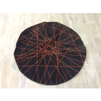 Product photograph showing Brown And Orange Web Round Rug Tw