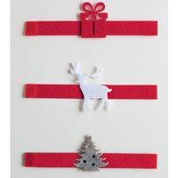 Accessoires de Table. 3 coloris : rouge, blanc et gris et 3 décors : sapin, cadeau, renne. Fermeture par scratch. Longueur : 16cm En feutrine