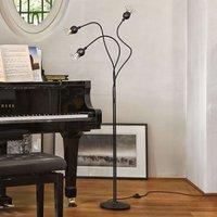 Designer floor lamp Poppy with a certain extra
