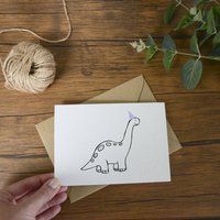 Dinosaur In A Party Hat Greeting Card