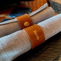 Set Of Four Personalised Leather Napkin Rings Tan