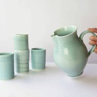 Pitcher And Four Tumblers